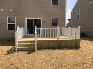 Wood deck vinyl railings