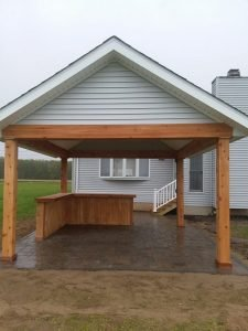 Paver patio and roof area with a bar